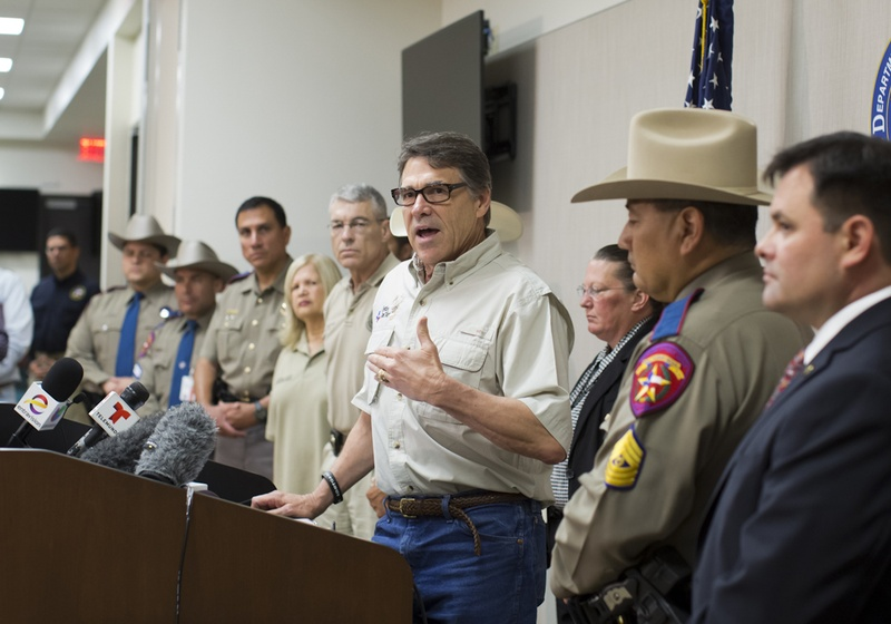 Gov. Perry and DPS Director Steve McCraw, speak to media following a tour to a federal facility housing unaccompanied alien children in Weslaco, Texas June 23rd, 2014. The state is providing $1.3 million per week to commence surge operations to help combat crime along the border.