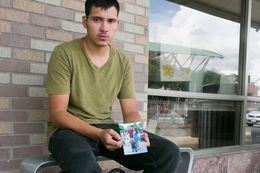 """Julio Cesar Garcia Duarte, holds a photograph of his common law wife and son at a bus station in McAllen. He was told a """"coyote"""" would deliver them to the Rio Grande but doesn't know their whereabouts."""
