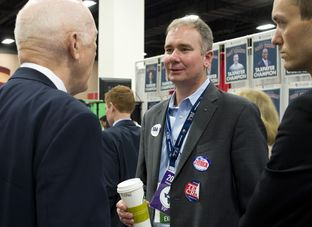 Republican activist Michael Quinn Sullivan visits at the State Republican Convention trade show on June 6, 2014.