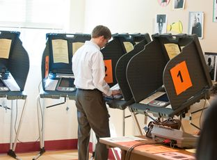 A man casts his ballot in a 2014 election.