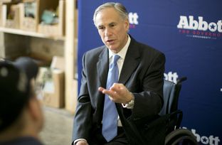 Republican attorney general and gubernatorial candidate Greg Abbott speaks one-on-one with members of the media following his appearance at a Congress Avenue coffeehouse on July 10, 2014.
