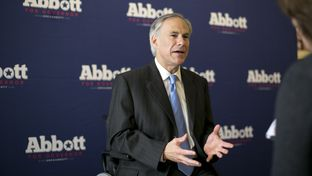 Republican Gubernatorial candidate, Greg Abbott, speaks one-on-one with members of the media following his his appearance at a Congress Ave. coffee house on July 10th, 2014