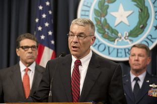 DPS chief Steve McCraw outlines plans for the National Guard role securing the Texas border as Gov. Rick Perry, l, and Guard Adjutant General John Nichols listen on July 21, 2014.