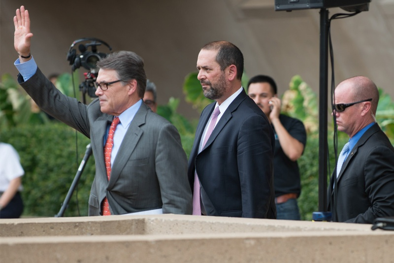 Gov. Rick Perry leaving a pro-Israel rally followed by adviser Jeff Miller on July 30, 2014, at Dallas City Hall.