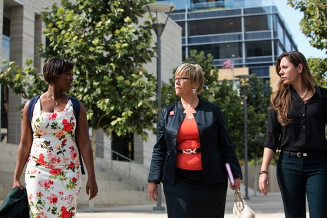 Amy Hagstrom Miller, center, chief executive of Whole Woman's Health, the lead plaintiff in an abortion lawsuit, outside the federal courthouse in Austin on Aug. 4.