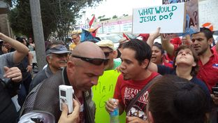 Border Convoy's Pete Santilli and La Unión del Pueblo Entero's John-Micheal Torres exchange words during a rally in McAllen on Friday.