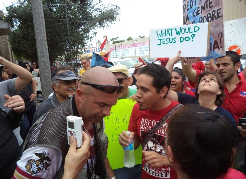 Border Convoy's Pete Santilli and La Unión del Pueblo Entero's John-Micheal Torres exchange words during a rally in McAllen on Friday.