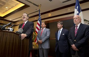 Gov. Perry's legal team, including, l to r,  David Botsford, Tony Buzbee, Bobby Birchfield and Ben Ginsberg meet the press on Aug. 18, 2014.