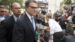 Gov. Rick Perry leaves the Blackwell-Thurman Justice Center in Austin after his booking on Aug. 19, 2014.