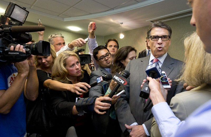 New England journalists surround Gov. Rick Perry after Friday's Portsmouth business luncheon.