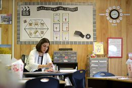 Third-grade teacher Liliana Kendrick prepares for her second year teaching in a portable classroom at Whitestone Elementary School in Leander on Aug. 21, 2014.