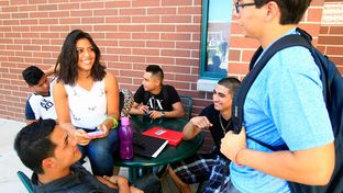 Freshman Samantha Salas (center) hangs out with friends before going to class on the first day of school on Aug. 25, 2014, at South Texas College's Pecan Campus in McAllen.