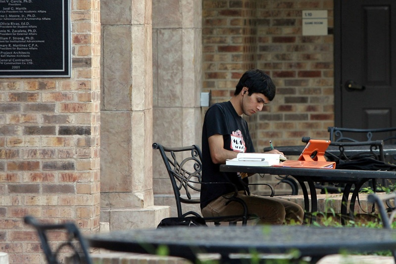 A student works on the campus of what was then the University of Texas at Brownsville. The university is now part of the University of Texas-Rio Grande Valley.