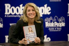 """Texas Democratic gubernatorial candidate Sen. Wendy Davis shows her book """"Forgetting to be Afraid"""" at Book People on September 11th, 2014"""