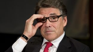 Gov. Rick Perry adjusts his glasses during his appearance at the Texas Tribune Festival on Sept. 21.