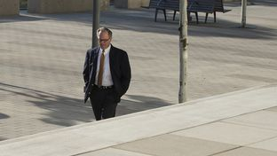 Former David Dewhurst consultant Buddy Barfield walks to Austin federal court in October, 2014, to plead guilty to embezzling almost $2 million in campaign funds.