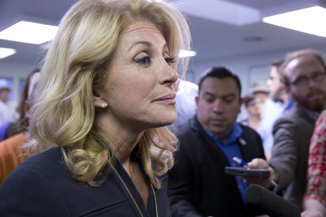 State Sen. Wendy Davis speaking to the press after a Travis County Democratic campaign rally on Oct. 22, 2014.