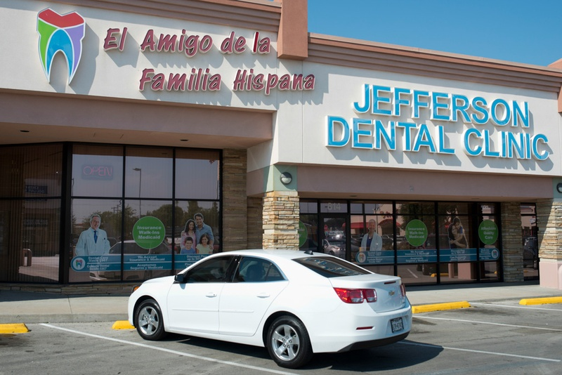 "A nod to the city's changing demographics, the masthead for a branch of Jefferson Dental Clinics in Irving, Texas includes a large Spanish-language sign on its storefront that reads, ""A friend of the Hispanic family."""