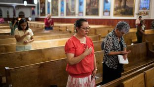 Parishoners attend a Friday service at Our Lady of Guadalupe Church in El Paso.