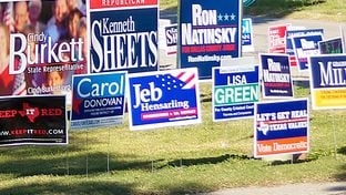 Signs greeting early voters are shown in October 2014 outside the Lakeside Activity Center in Mesquite.