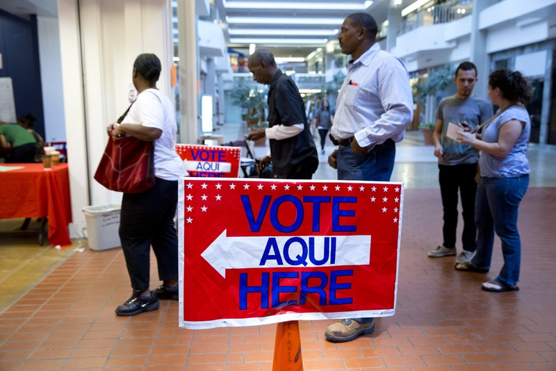 Travis County residents line up to vote at Austin's Highland Mall on Nov. 4, 2014.