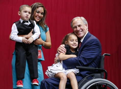 Republican Greg Abbott celebrates with family after winning governor's race in a landslide.