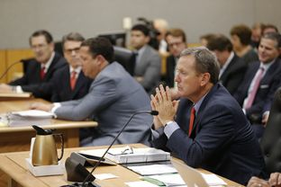 Prosecutor Michael McCrum gathers his thoughts as testimony continues in Travis County District Court on the Gov. Rick Perry case on Nov. 6, 2014.