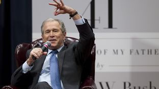 Former President George W. Bush tells a story about his father at Texas A&M University on Nov. 11, 2014.