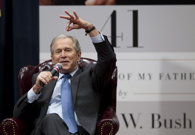 Former President George W. Bush tells a story about his father at Texas A&M University on Nov. 11.