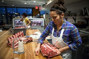 Julia Poplawsky, 26 years old and butcher at Dai Due Butcher Shop & Supper Club in Austin, and her assistant Ashley Chaney, 28, work to prepare cuts of beef on Nov. 11, 2014.