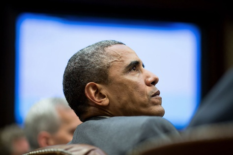 President Barack Obama meets with advisors in the Roosevelt Room of the White House, Aug. 4, 2014.