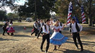 Clad in traditional Czech garb, the West High School Jr. Historians perform a folk dance before the groundbreaking of the West Sokol gymnasium.The explosion of the West Fertilizer plant on April 17, 2013 destroyed the gymnasium and meeting hall that sat there before.