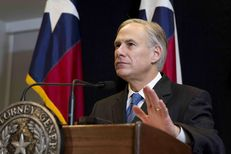 Attorney General Greg Abbott speaking on Dec. 3, 2014, about the lawsuit filed by Texas and other states against the Obama administration over immigration policy.