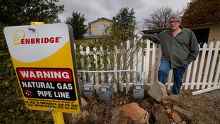 Some rural Texans, including Jon Salis, have been getting untreated natural gas that can freeze up and, in rare cases, pollute homes. Salis poses at the gas line near his Lake Palo Pinto property.