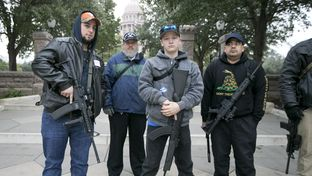 Activists who support a legislative proposal that would lift the state's handgun licensing requirements stand outside the state Capitol on the opening day of the Texas Legislature on Jan. 13, 2015.