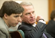 Health and Human Services Executive Commissioner Kyle Janek whispers to an aide at a hearing of the Sunset Advisory Commission on Jan. 14, 2015.