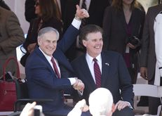 Newly sworn in, Gov. Greg Abbott and Lt. Gov. Dan Patrick watch the inaugural parade up Congress Avenue in Austin, Texas on January 20, 2015.