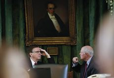 Lt. Gov. Dan Patrick meets privately with Sen. Kel Seliger, R-Amarillo, on the dais during a break in Senate proceedings Jan. 21, 2015.