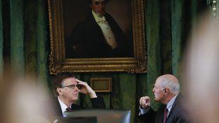 Lt. Gov. Dan Patrick meets privately with Sen. Kel Seliger, R-Amarillo, on the dais during a break in Senate proceedings Jan. 21, 2015.