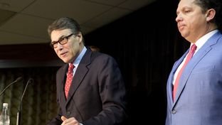 Former Gov. Rick Perry at Jan. 28 press conference with his lead attorney, Tony Buzbee.