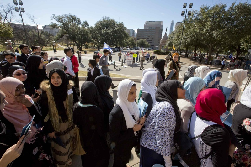A group of school children look on at the Texas Muslim Capitol Day ceremony.