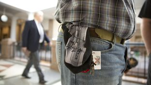 Jason Orsek with Come and Take it America wears a cloth gun holder with a photo of a gun imprinted on it at the Texas Capitol on Feb. 12, 2015, when the Senate Committee on State Affairs heard testimony on gun-related bills.