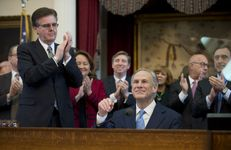 Lt. Gov. Dan Patrick, l, applauds as Texas Gov. Greg Abbott is introduced Feb. 17, 2015 prior to his State of the State speech.