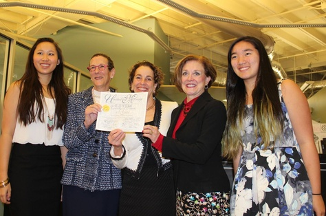 Sarah Goodfriend, second from left, and Suzanne Bryant, center, with their daughters (far left and far right) and Travis County Clerk Dana DeBeauvoir, second from right. DeBeauvoir issued Goodfriend and Bryant a marriage license on Feb. 19, 2015.