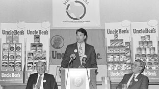 Rick Perry in 1991 at Uncle Ben's rice offices in Houston to promote his Make It Texas initiative. The program was designed to promote the agricultural processing industry with loan guarantees, but a high failure rate sank the program and triggered a $14.7 million bailout in 2009.
