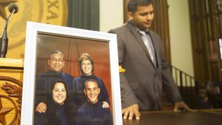 """Erick Muñoz, widow of Marlise Muñoz, speaks at the Texas Capitol after """"Marlise's Law"""" was introduced during a press conference on March 12, 2015. A picture of his late wife and her family sits on the table."""
