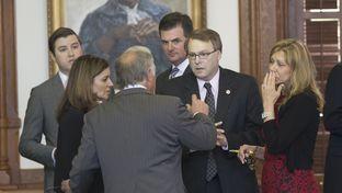 Sen. Kirk Watson speaks with the author of Senate Bill 11, Sen. Brian Birdwell, as Sen. Joan Huffman listens on. The Senate's campus carry debate began on Mar. 18, 2015.