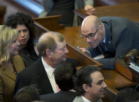 State Rep. Dennis Bonnen, R-Angleton, confers with State Rep. John Otto, R-Dayton, during a point of order called on House Bill 11 on March 18, 2015.