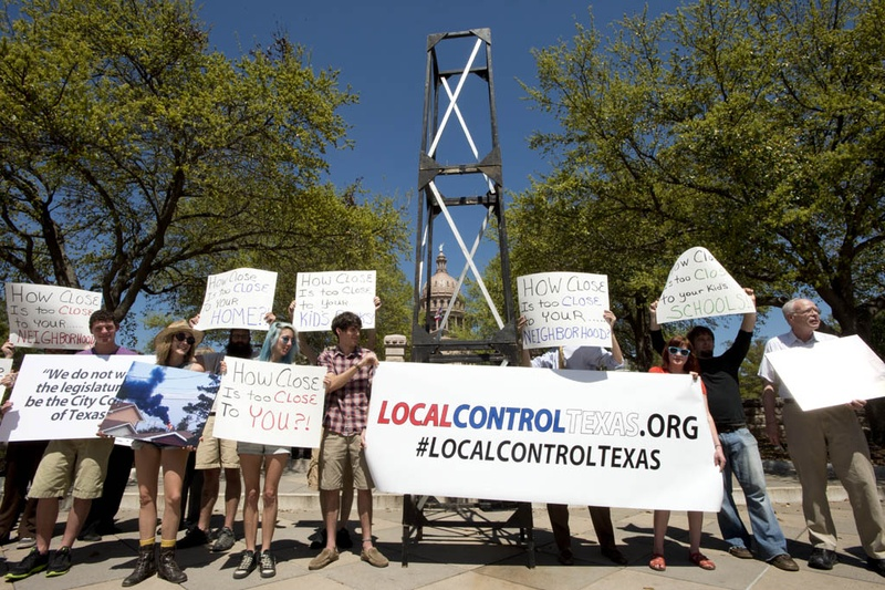 Local control activists and the Texas Campaign for the Environment rally with a mock-up oil rig at 11th and Congress during action on Mar. 23, 2015.