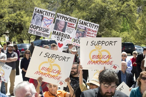 During the Defense of Texas Marriage Amendment Rally on Mar. 23, 2015 at the Texas Capitol, a protester raises questions of marriage sanctity noting celebrities who've been married multiple times.